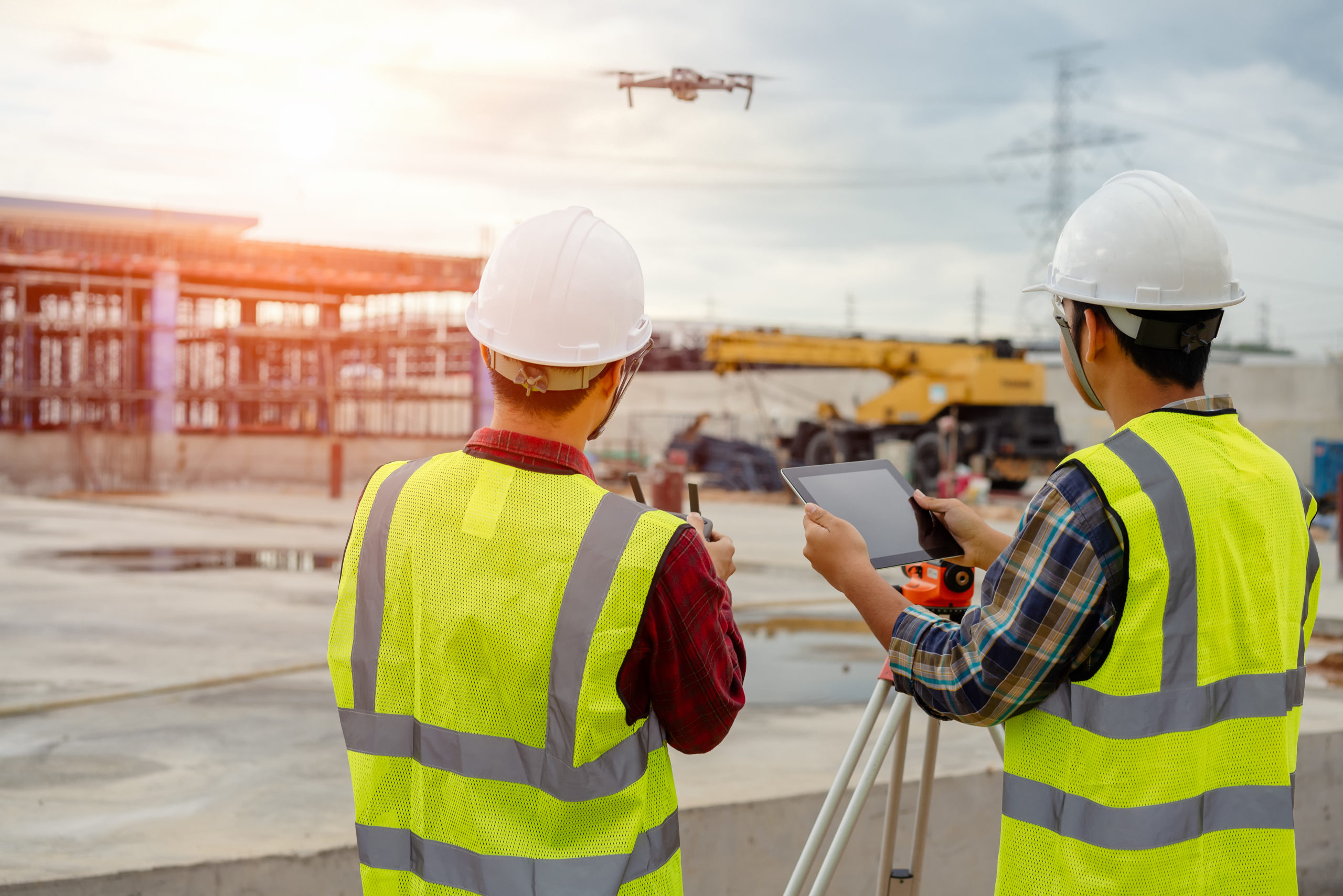 Two Construction Contractors Operating a Drone.