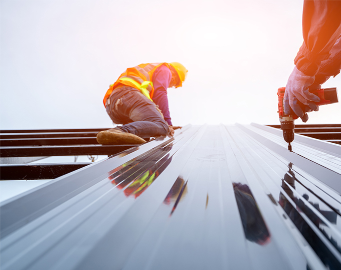 Two Los Angeles contractors installing a new roof