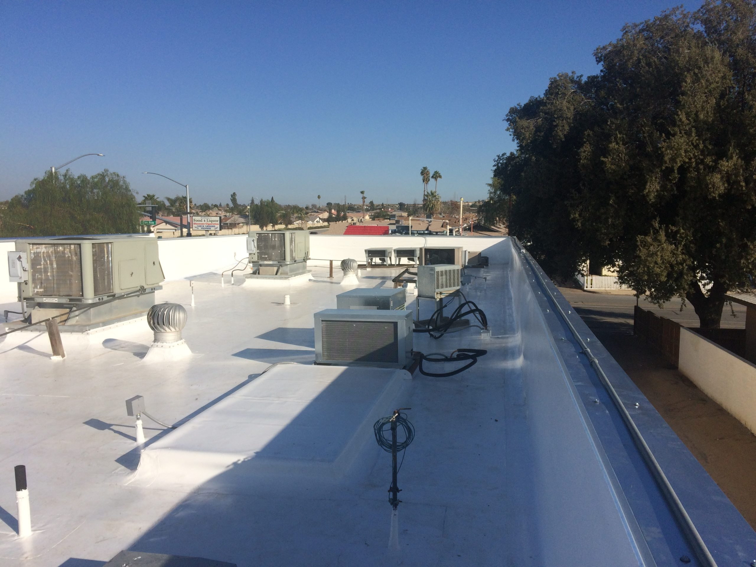 A Los Angeles building's rooftop with a new roof drain system