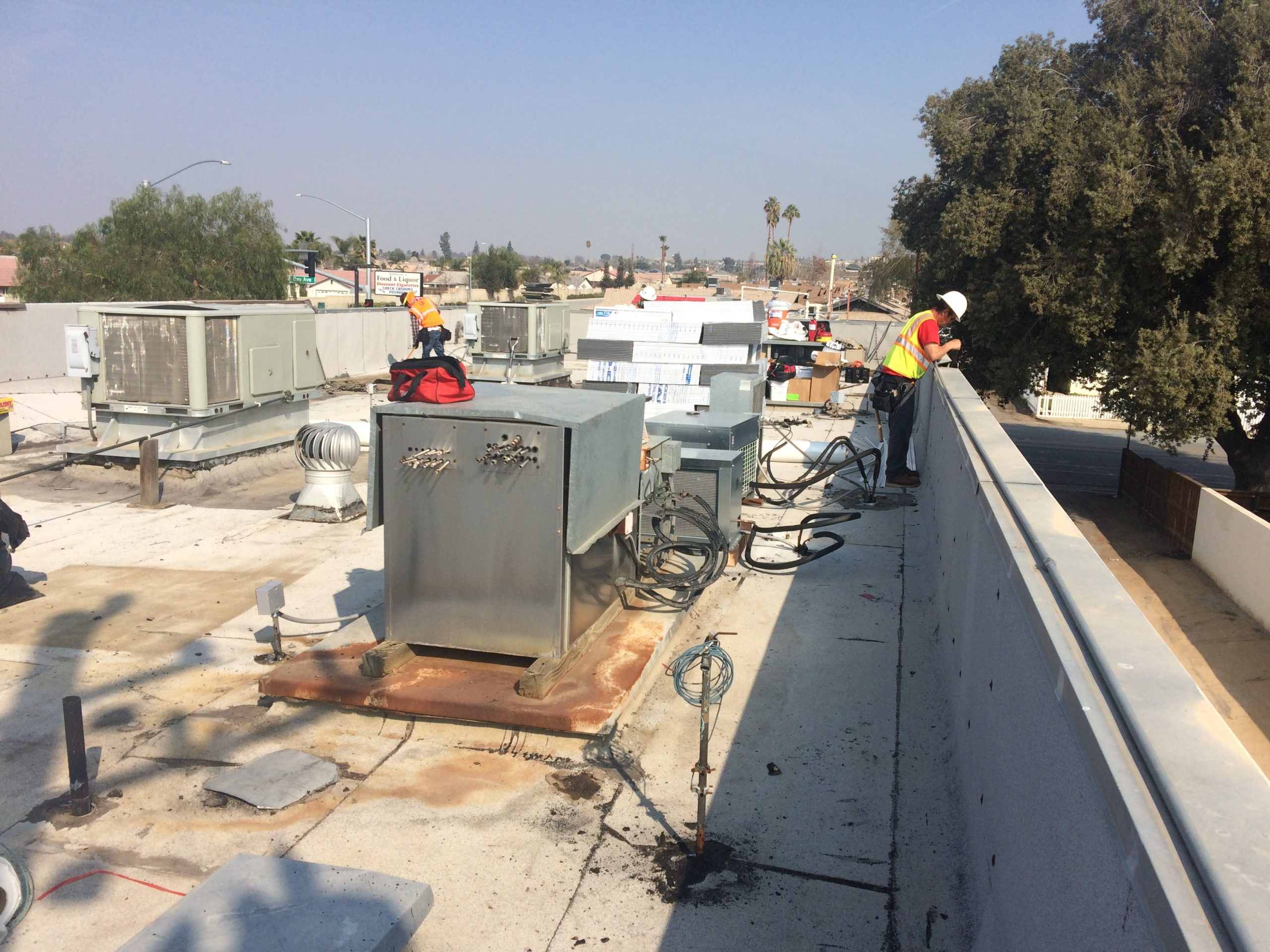Two Los Angeles roofing contractors working on a roof