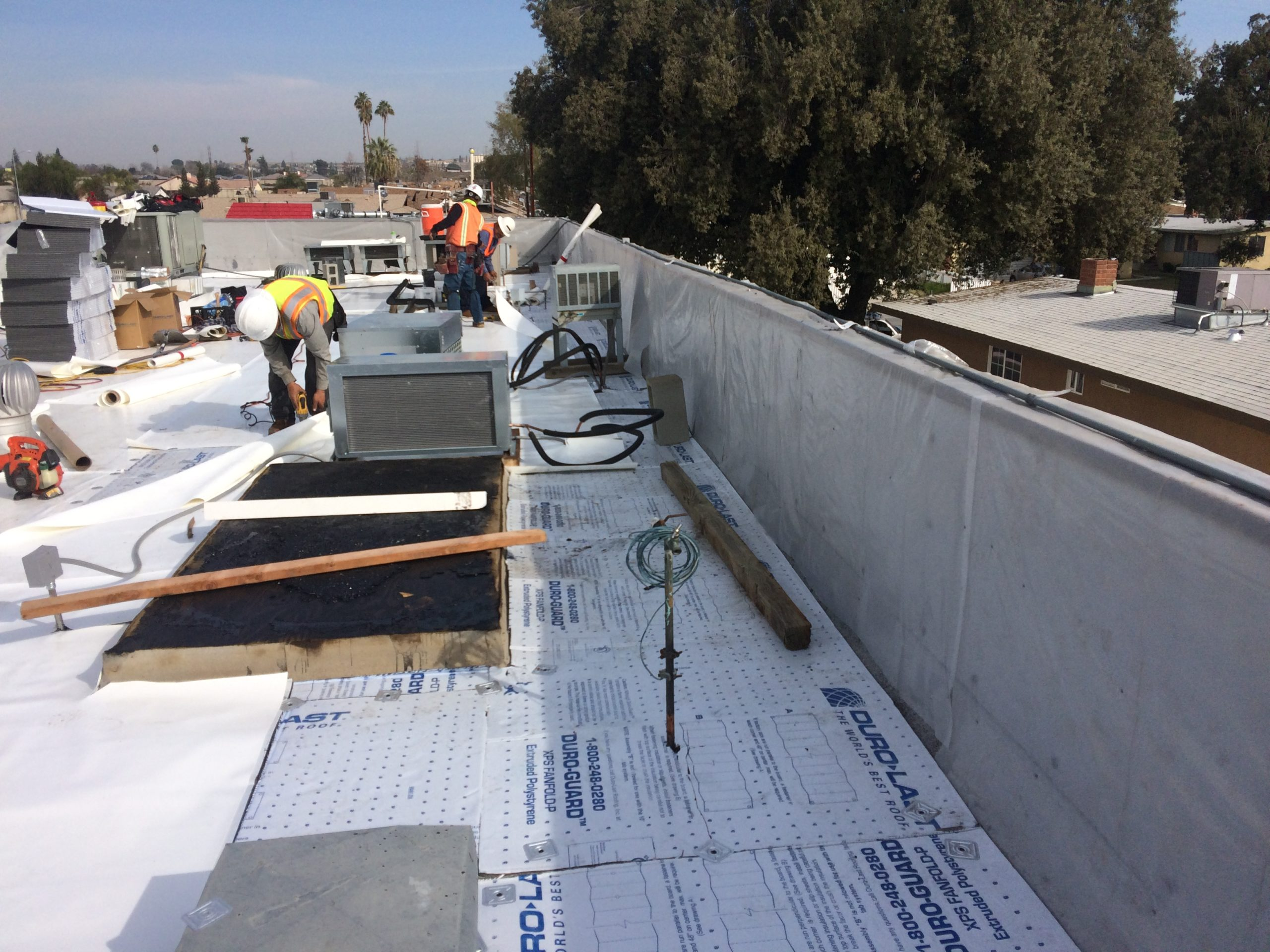 Los Angeles roofing contractors improving a building's roof