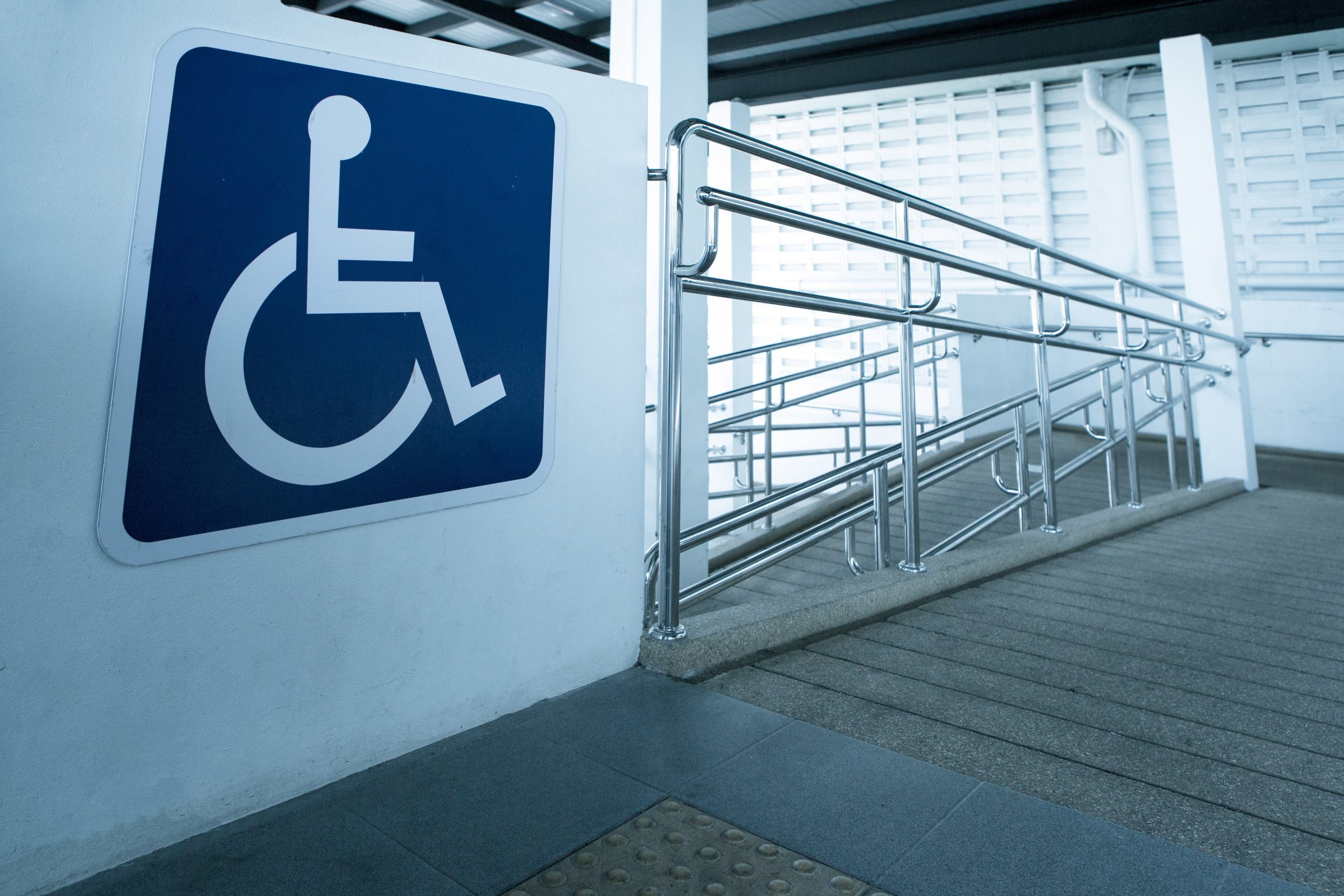 An ADA-compliant ramp with an International Symbol of Access