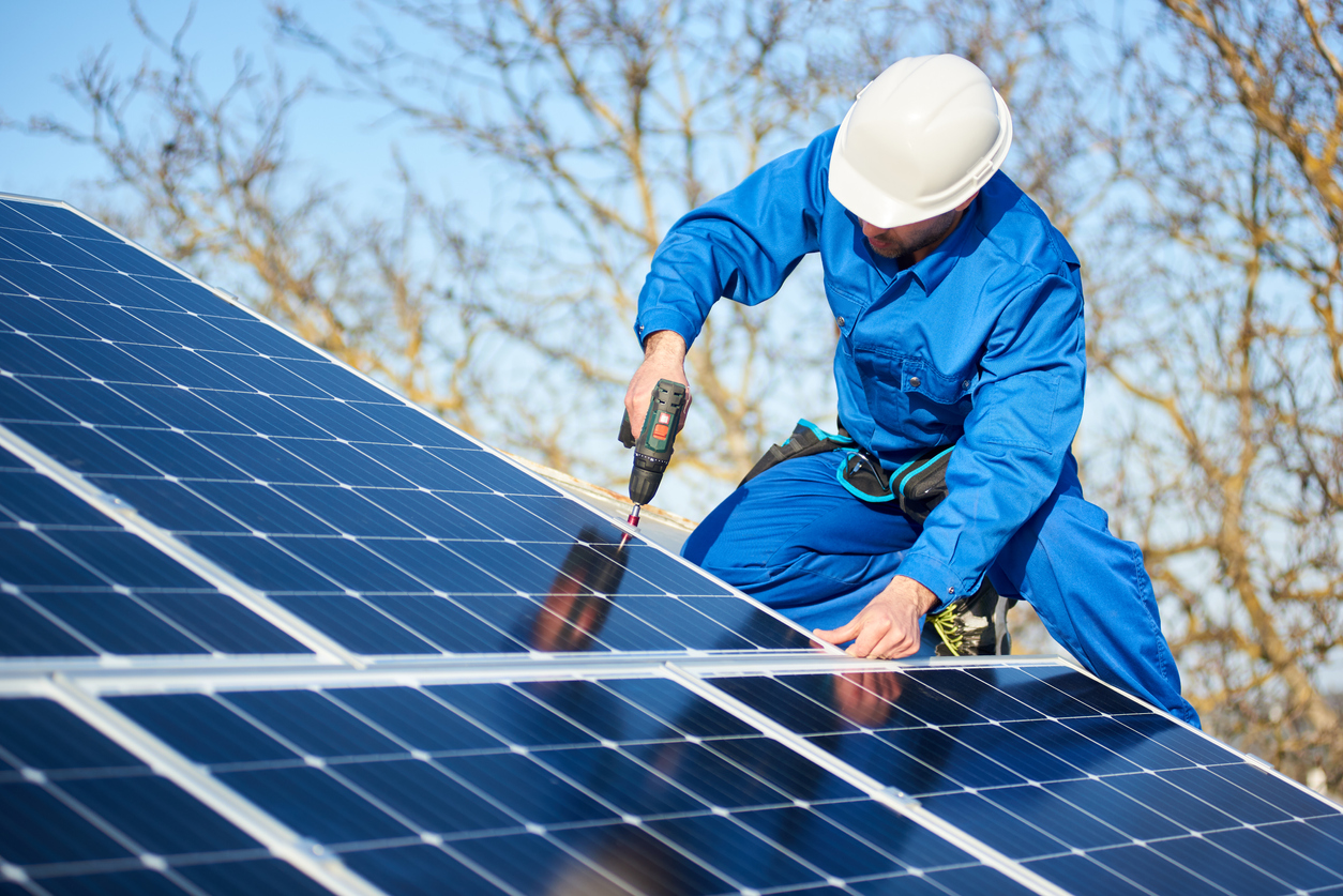 Electrical contractor installing solar panels