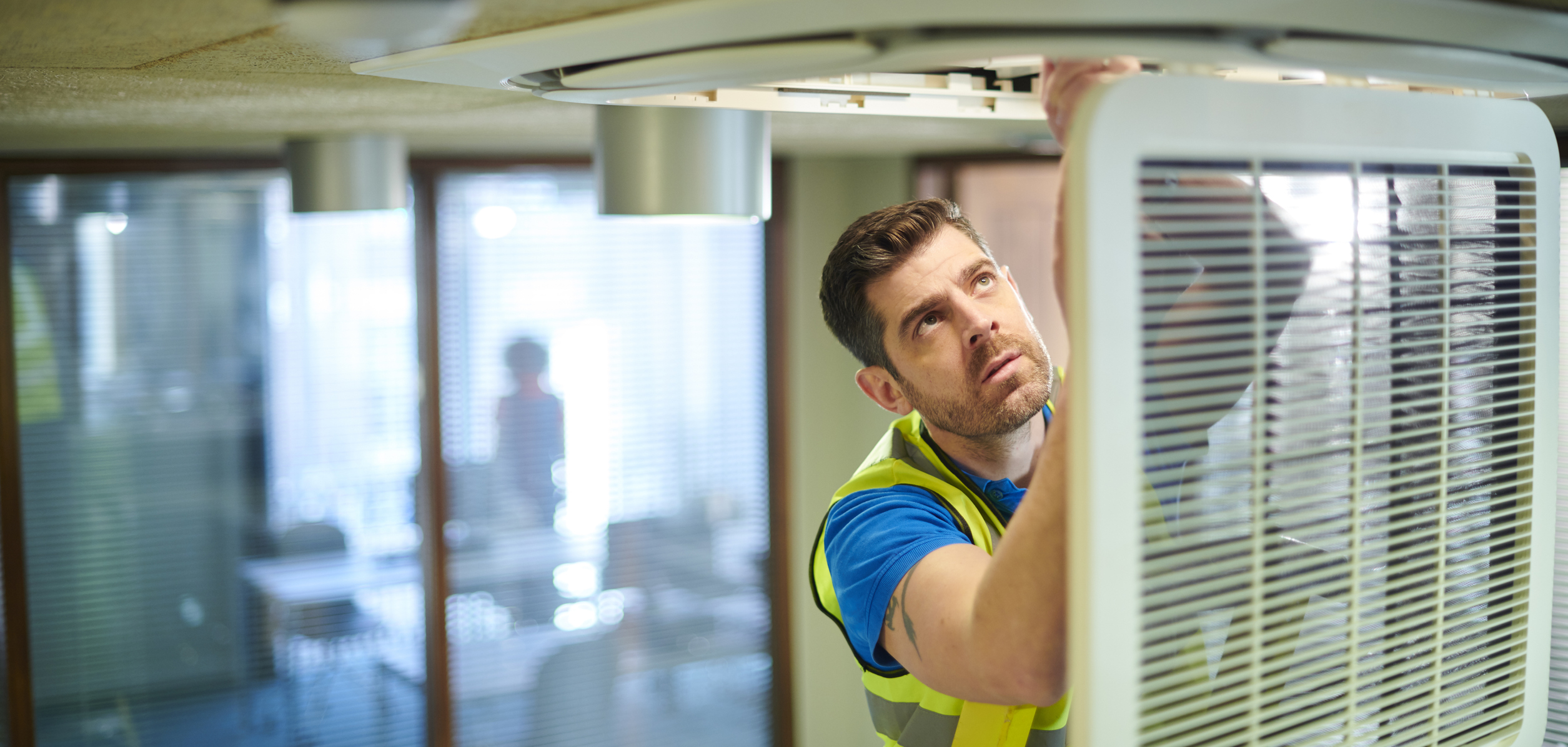 HVAC Contractor Fixing HVAC System