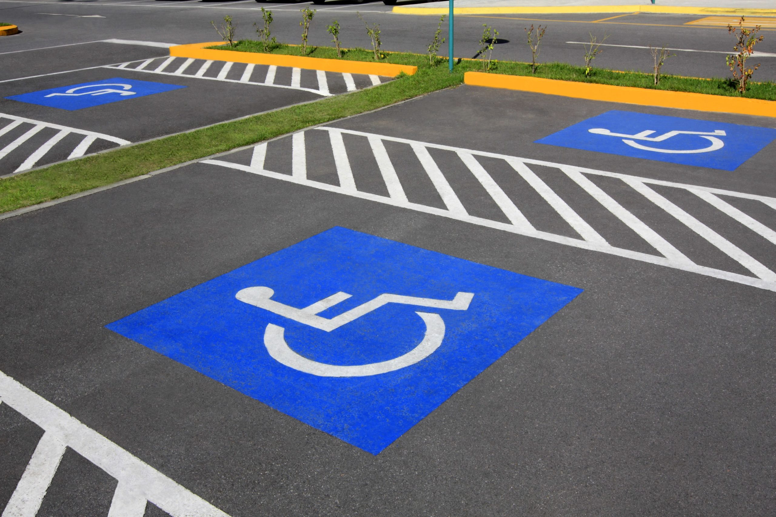 A handicap parking space in an ADA-compliant parking lot