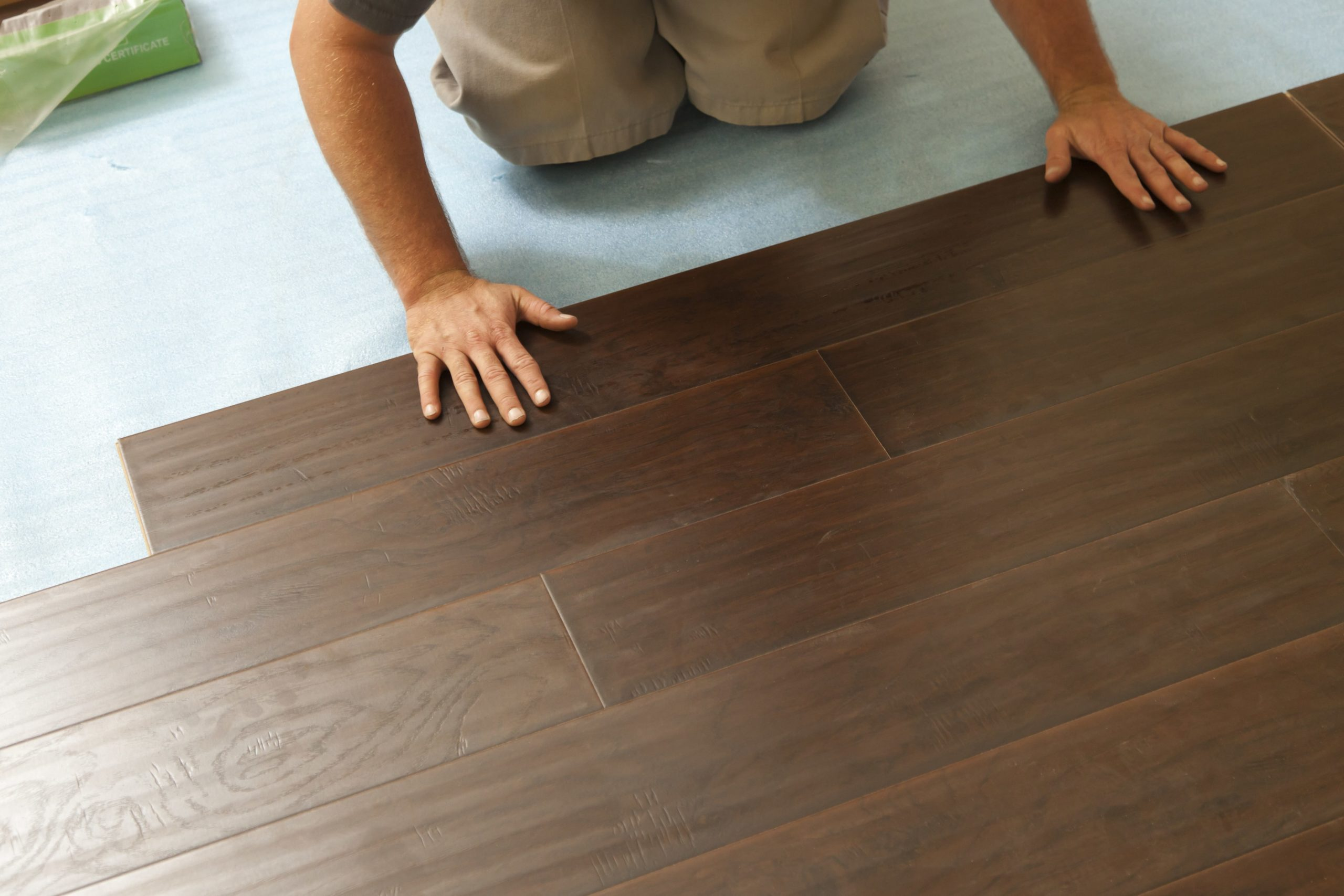 A contractor setting up vinyl floor