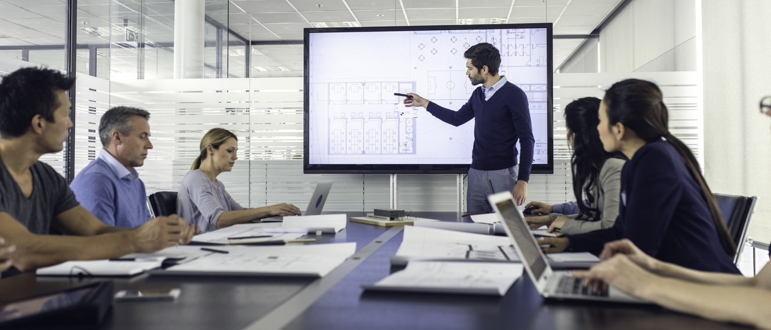 Project managers planning a Los Angeles construction project in a conference room
