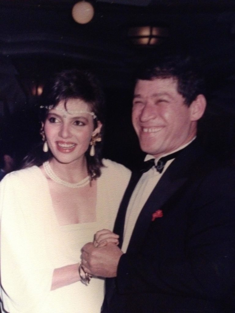 Abe and Inna Tuler holding hands and smiling for a picture at an event