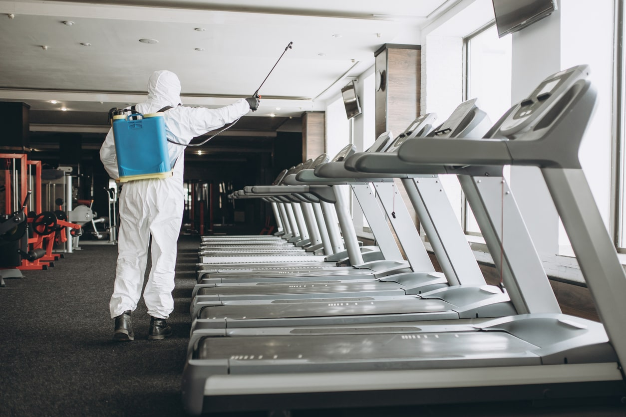 A sanitation worker cleaning a Los Angeles gym