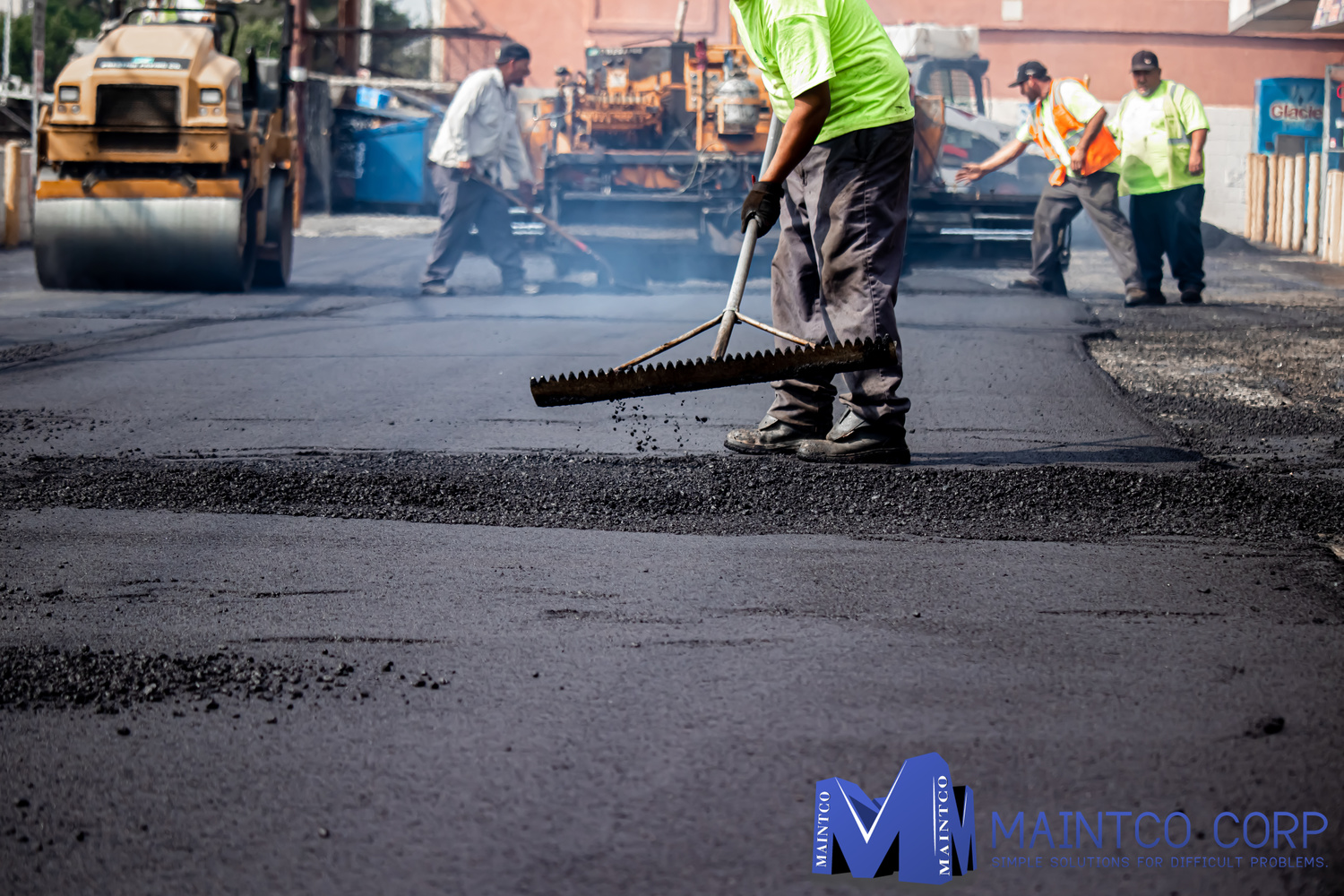 Maintco employees finishing up a parking lot paving project