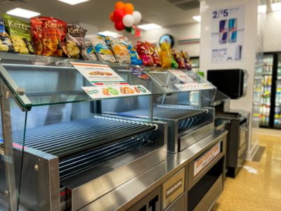 Stocked shelves inside a 7-Eleven renovated by Maintco Corp