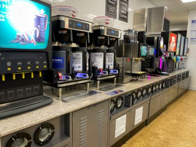 Beverage machines inside a 7-Eleven built by Maintco Corp