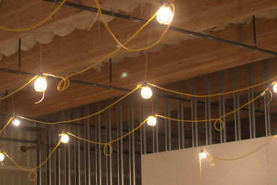 Eight hanging light bulbs installed at the Carbon Health job site