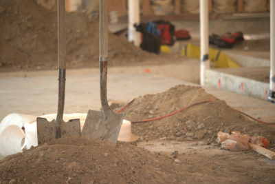 Two shovels stuck in a pile of dirt at Carbon Health