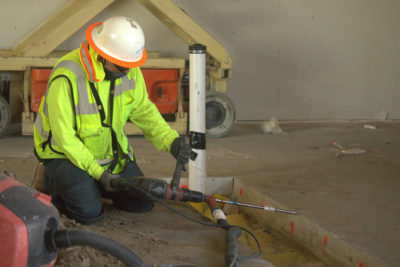 Maintco Corp employee installing a new underground pipe at Carbon Health
