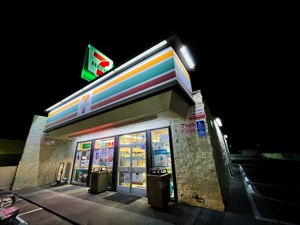 The exterior of a 7-Eleven in Woodland Hills during nighttime