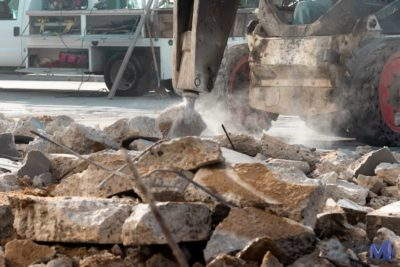 Close up of a skid steer beginning a paving project