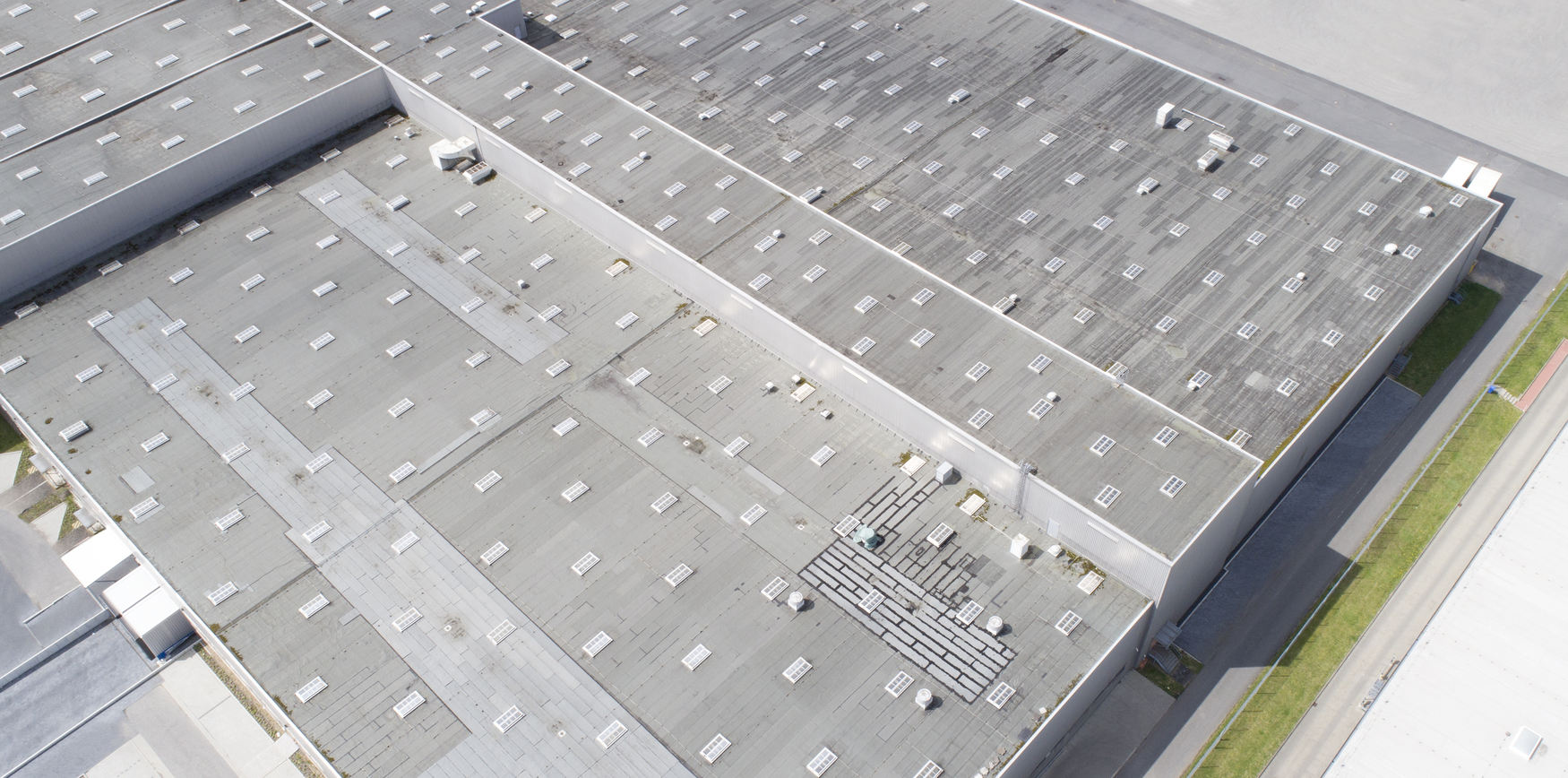 A large cool roof on an industrial building
